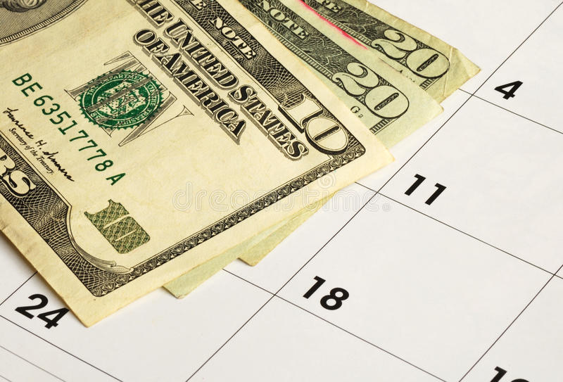 Money on a calendar stock photo
