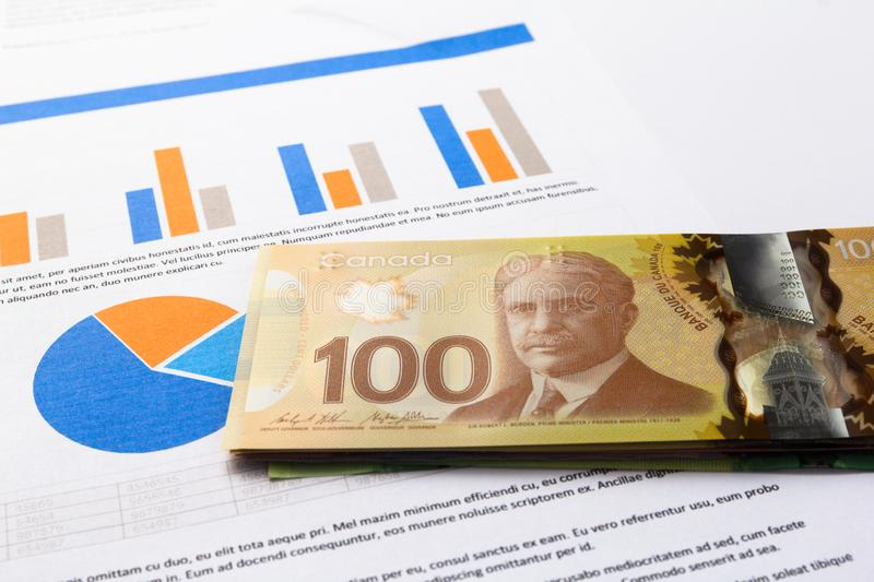 Money from Canada. Dollars. Bills spread on statistics graphic mockup royalty free stock photography