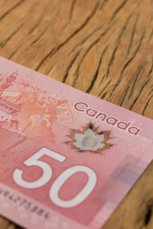 Money from Canada. Dollars. Close up of cash bills on rustic woo stock images