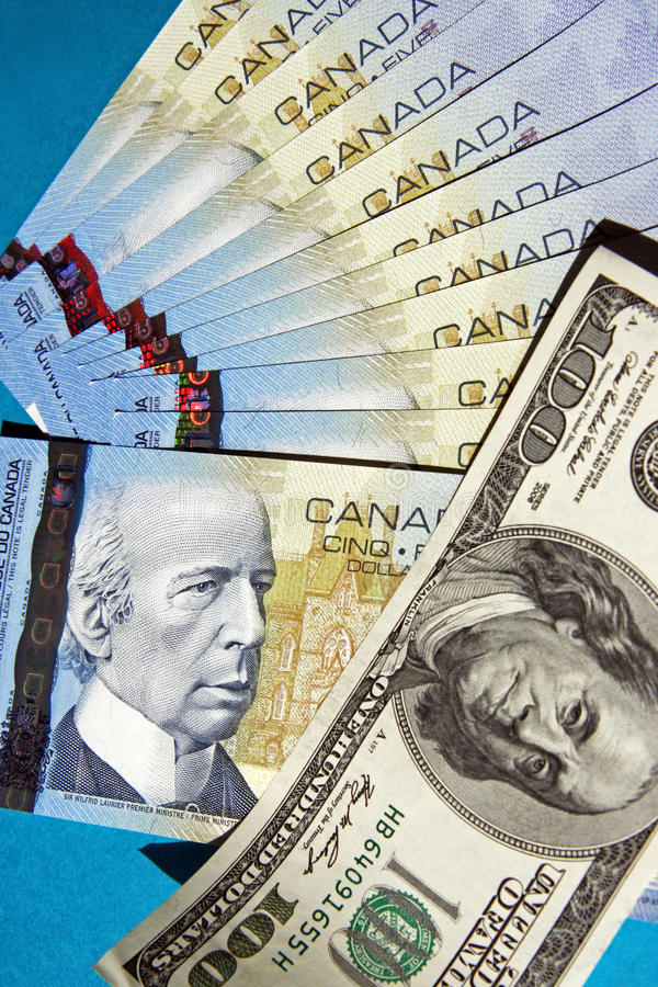 Money of Canada and the USA. Fan from banknotes in five Canadian dollars and 100 dollar denomination of the USA stock photos