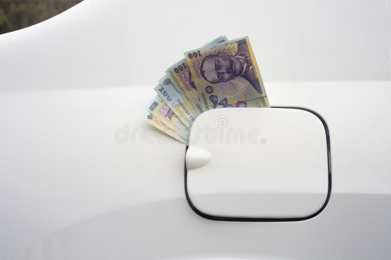 Money in the car fuel tank. royalty free stock photography