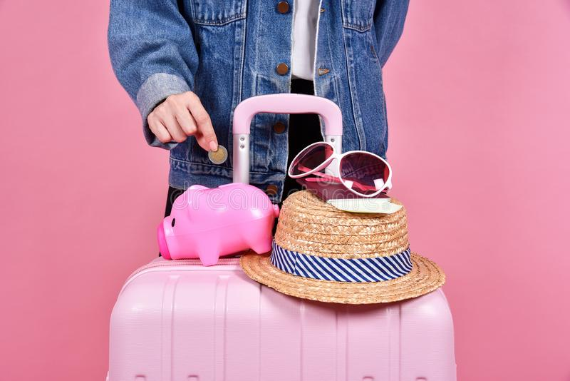 Money cash saving for travel concept, Traveler and pink suitcase. Money cash saving for travel concept, Traveler and pink suitcase, Passenger and passport stock photo