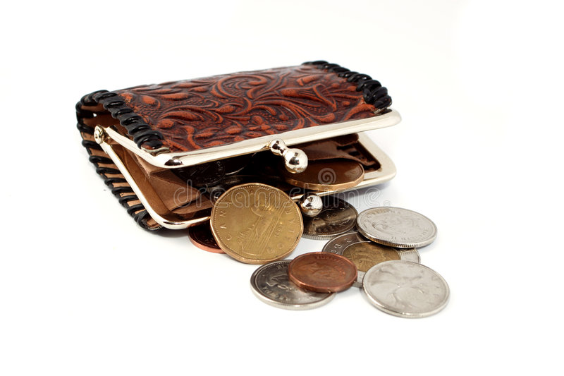 Money change purse. Money falling out of change purse stock images