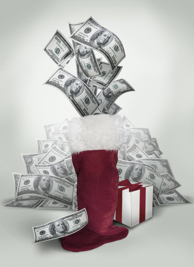 Money in Christmas Stocking. United states one hundred and fifty dollar bills popping out of a red Christmas stocking royalty free stock photo