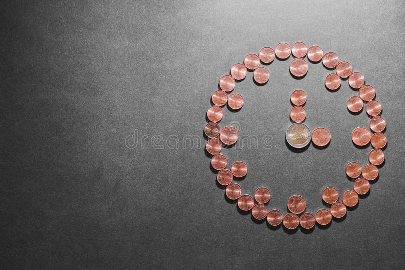 Money clock. Euro coins made into a clock for your financial concepts about time - copy space to the left stock photo