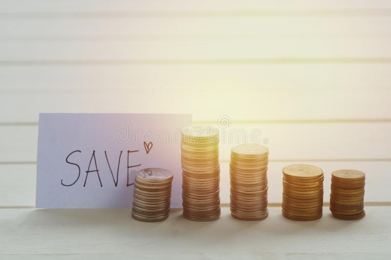 Money coin deposit of save money for prepare in the future. save sign with coin. On table stock images