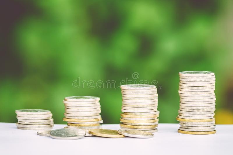 Money coin stack growing graph with green background stock photography