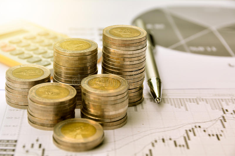 money coins with graph paper and calculator, finance and growth stock photo