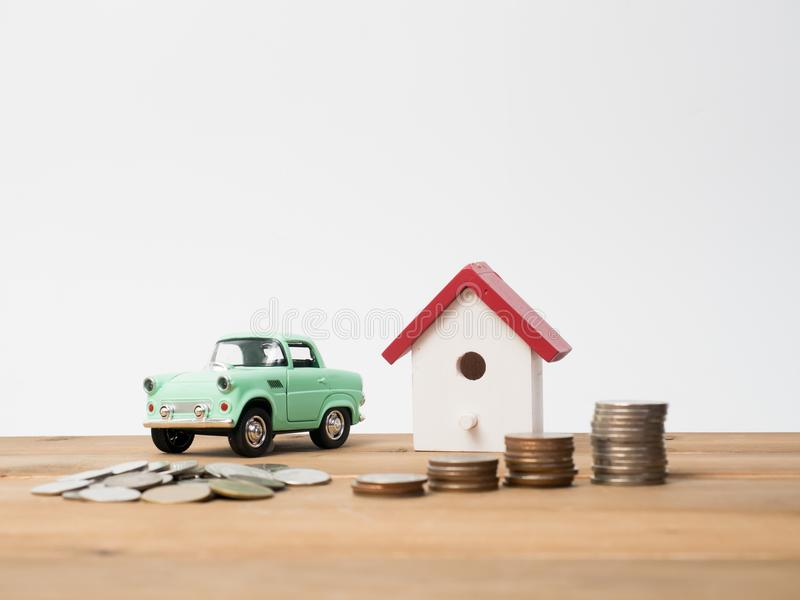 Money coins stack growing with red house on wood background. Bus royalty free stock photography