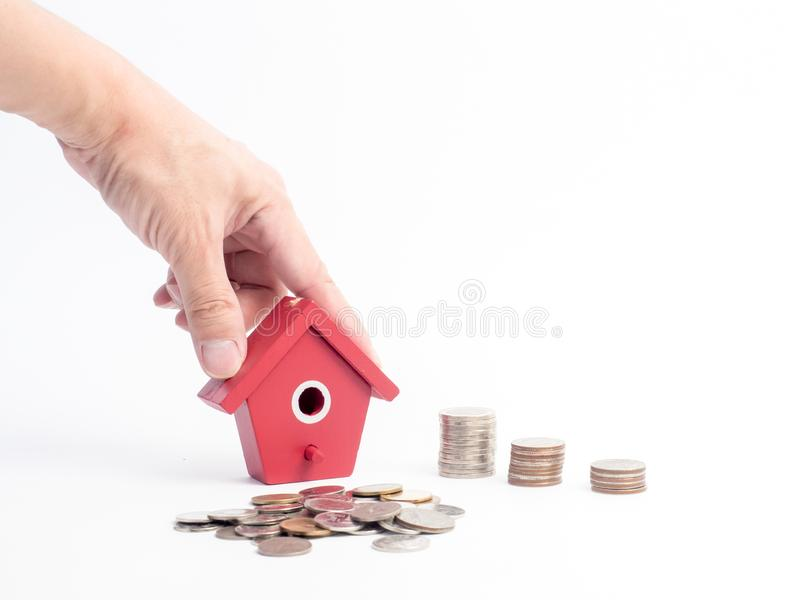 Money coins stack growing with red house on wood background. Business growth investment and financial concept ideas.Real estate in. Vestment. House and coins on royalty free stock photography