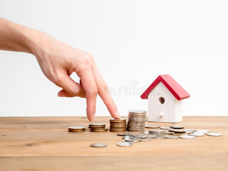 Money coins stack growing with red house on wood background. Business growth investment and financial concept ideas.Real estate in. Vestment. House and coins on stock images
