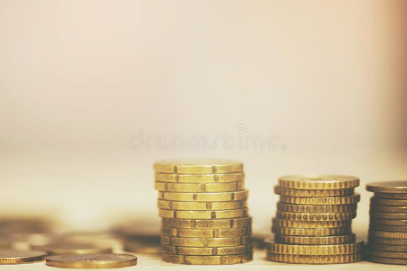 Money coins stacked on each other in different positions on the wooden table. Credit financial growing business concept. Saving mo stock images