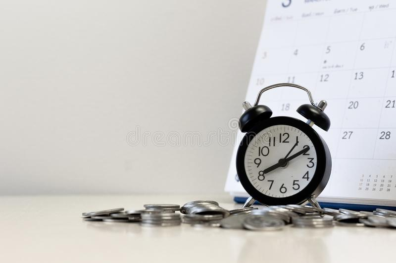 Money coins step with calendar and alarm clock ,Tax time and saving money and financial planning concept royalty free stock images