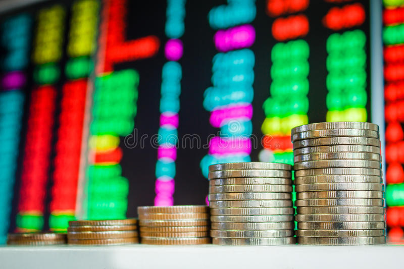 Money coins and Stock market. stock photos