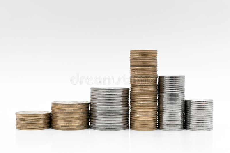 Money and coins on a white surface royalty free stock photography