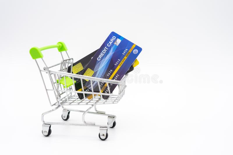 Money concept of Credit Cards in a Shopping Cart on isolate white background.  as background business concept and Saving concept royalty free stock image