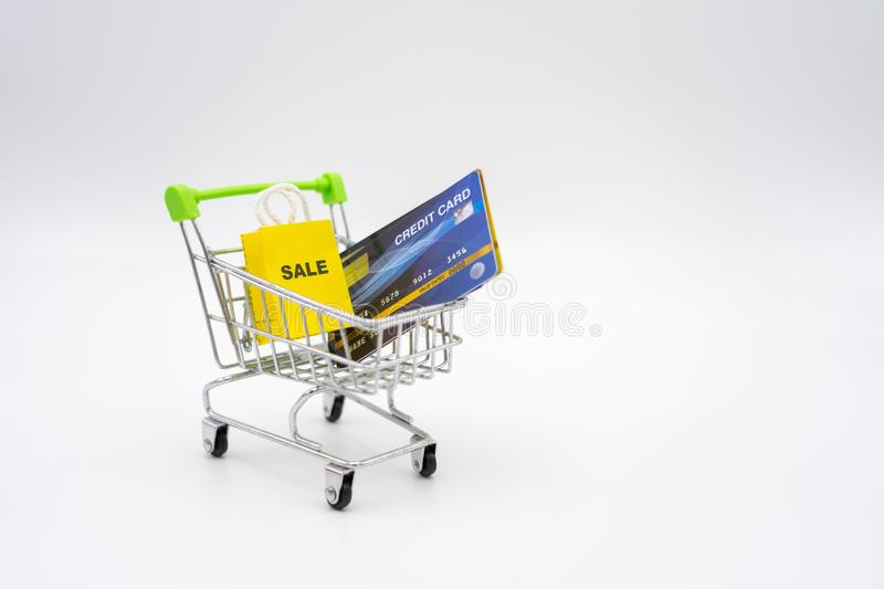 Money concept of Credit Cards in a Shopping Cart on isolate white background.  as background business concept and Saving concept stock image