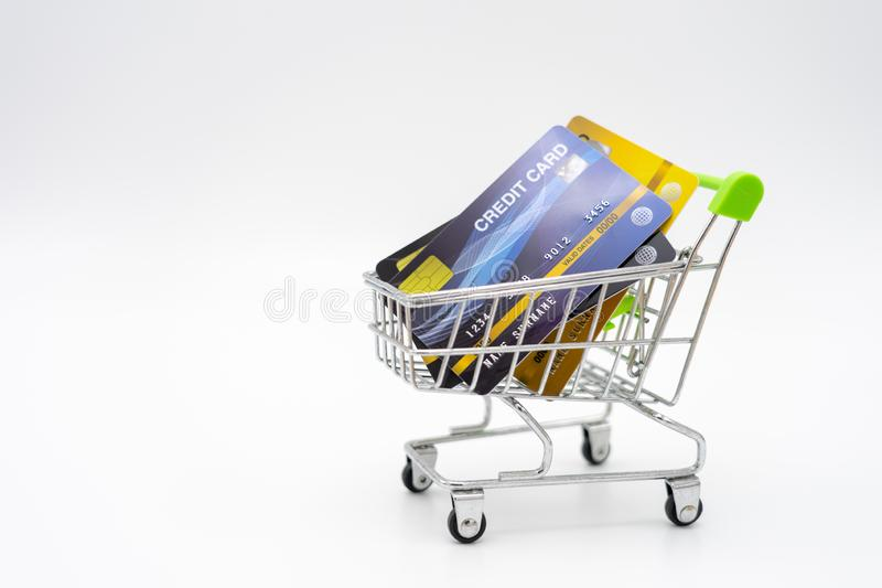Money concept of Credit Cards in a Shopping Cart on isolate white background.  as background business concept and Saving concept royalty free stock photo
