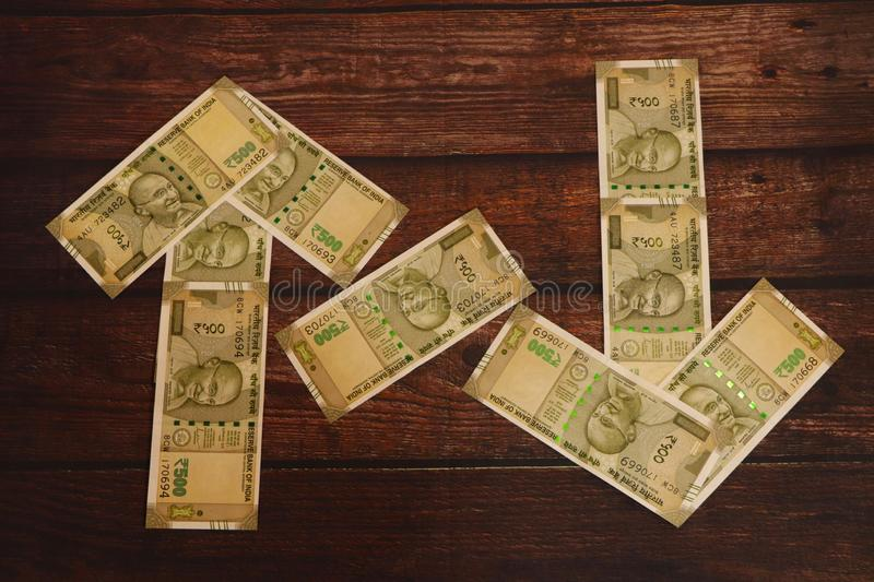 Money concept. Indian Currency showing ups and down. Money concept. Indian Currency showing ups and down of currency stock image