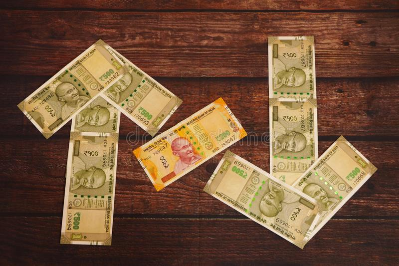 Money concept. Indian Currency showing ups and down. Money concept. Indian Currency showing ups and down of currency royalty free stock photos