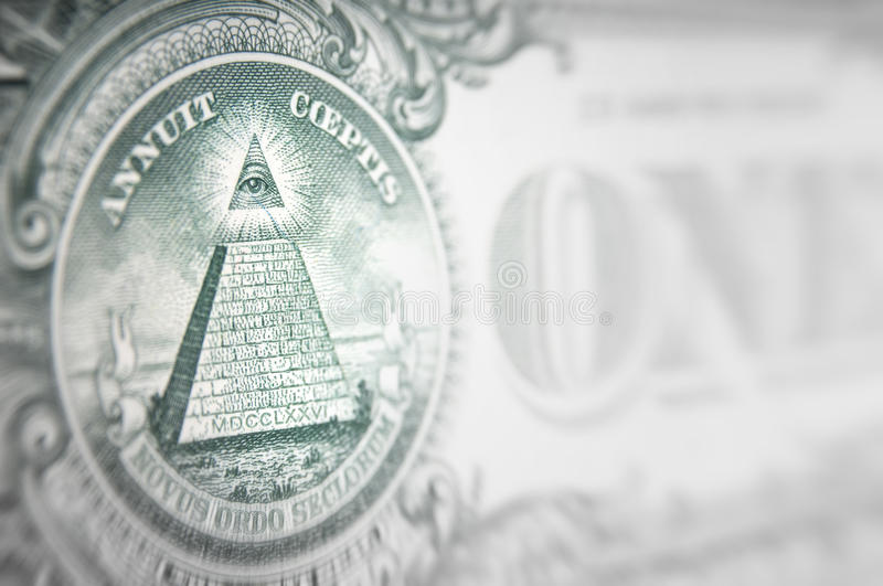 Money conspiracy concept. Detail of the pyramid with the eye royalty free stock photos
