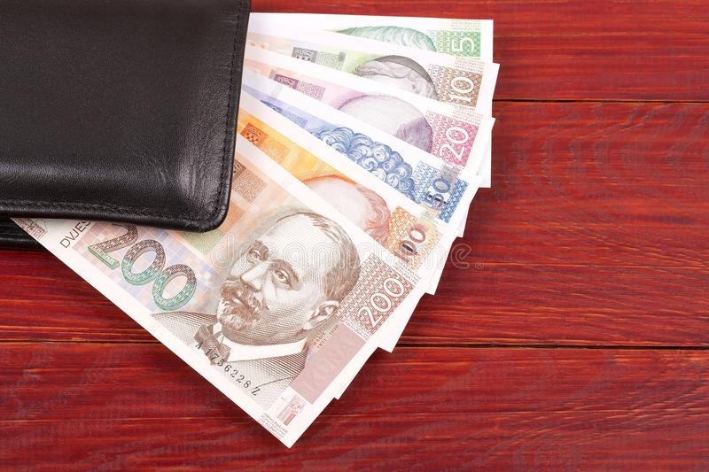 Money from Croatia in the black wallet. On a wooden background royalty free stock photography