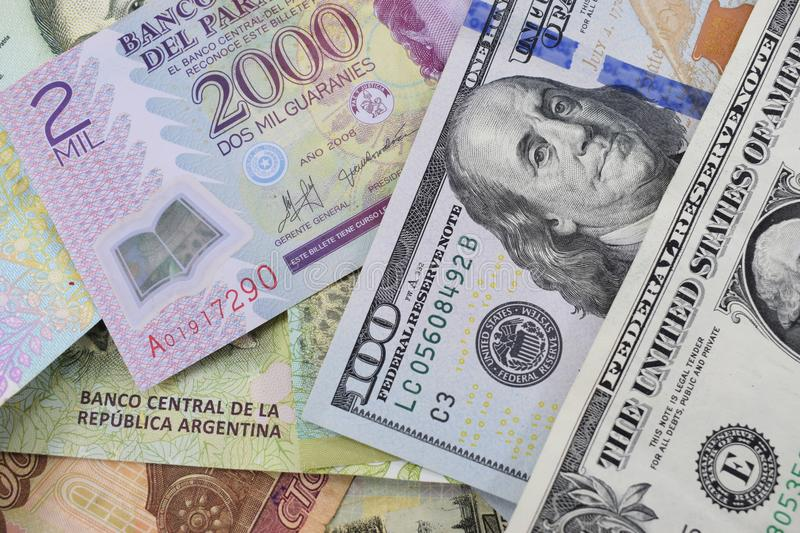 Money from different countries, dollars, Argentine and Paraguayan pesos, Russian rubles. Background. money from different countries, dollars, Argentine and stock images