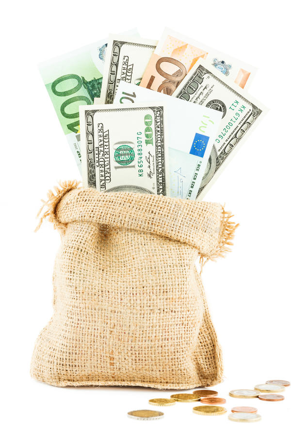 Money dollars and euros in the linen bag and coins scattered near royalty free stock photos