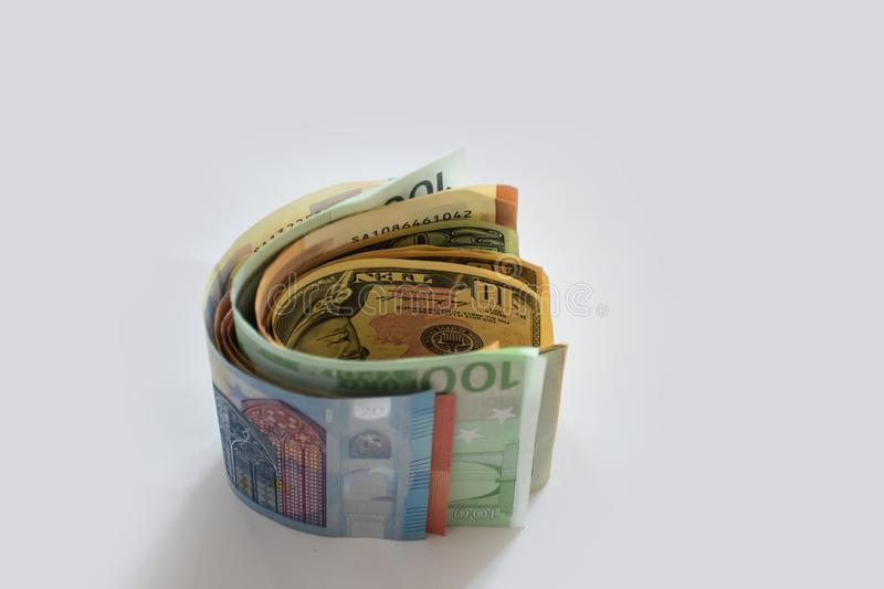 Money - dollars, euros and other currencies lie on the white surface stock image