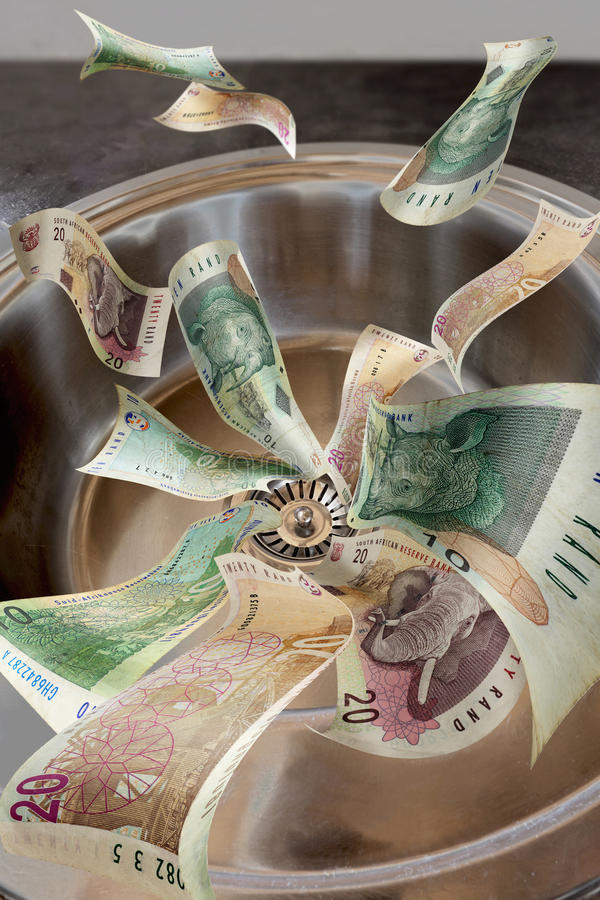 Money down the drain royalty free stock image