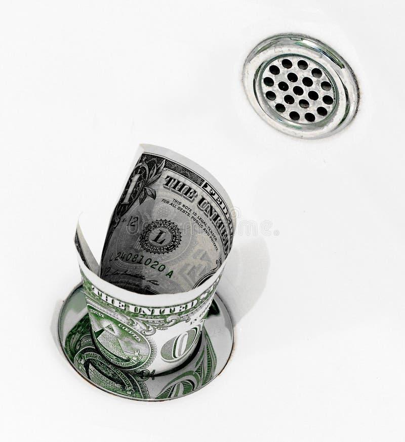 Money down the drain stock photos