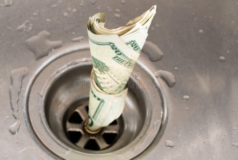 Money drain royalty free stock photo