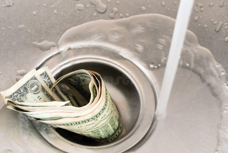 Money drain stock image
