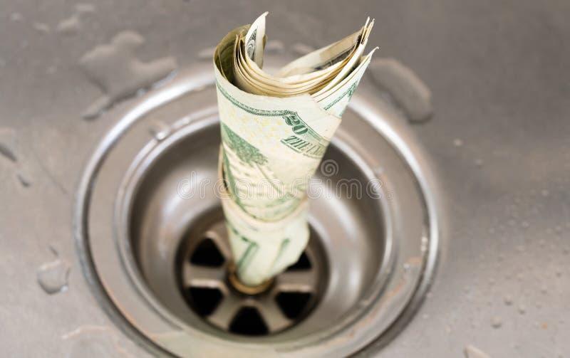 Money drain stock photo