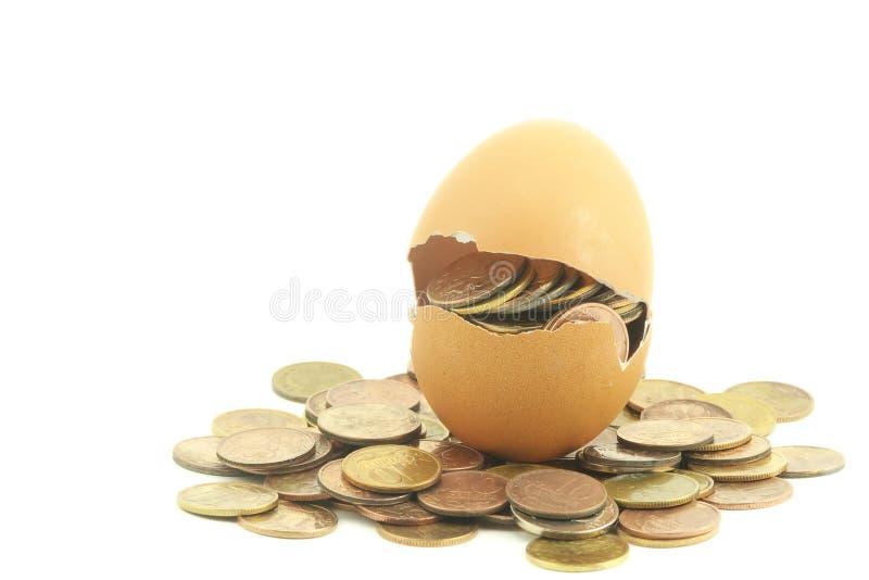 Money in egg royalty free stock photo