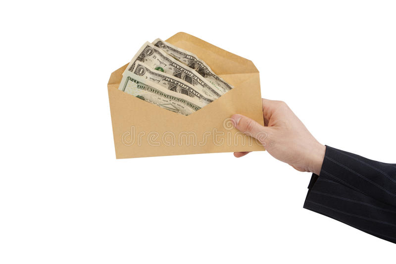 Money in Envelope. Hand holding an envelope full of money [with Clipping Path and isolated on white background stock photography