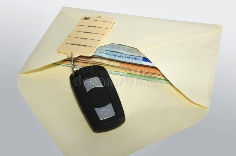 Money envelope with car keys. Open white money envelope with car key royalty free stock photos