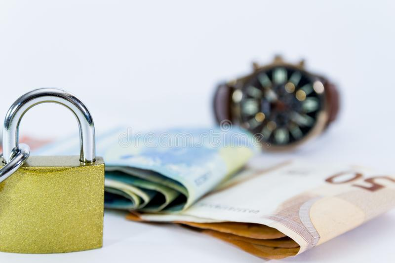 Money Euro value banknotes with padlock, European Union payment system. Isolated on white royalty free stock photos