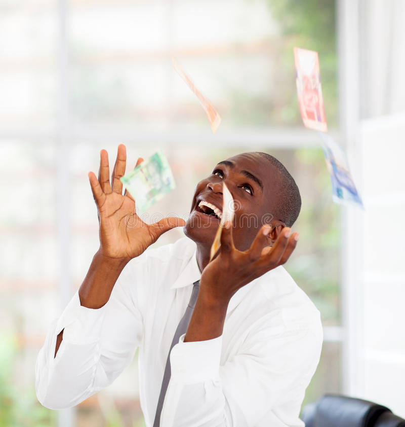 Money falling from above royalty free stock photography