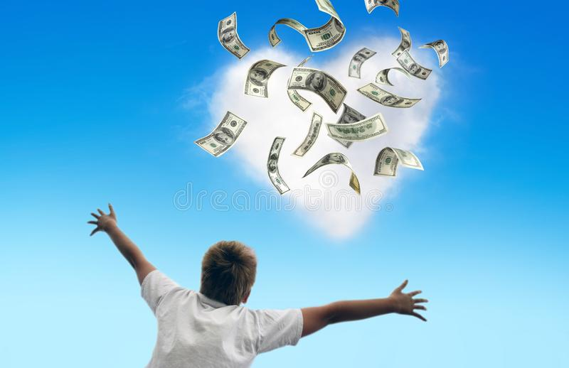 Money falling from the sky stock image