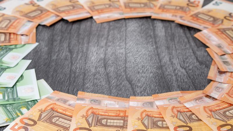 Money finance earning sector concept. Copy space for text. Stack of money wealth, lottery prizes or banking crises. Euro banknotes Laid out in a cicircle on a royalty free stock image