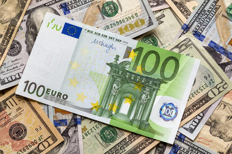 Money and finances concept. One hundred euro new bill on colorful abstract background of American national currency, dollar stock photo