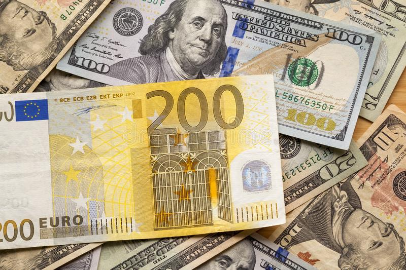 Money and finances concept. Two hundred euro new bill on colorful abstract background of American national currency, dollar royalty free stock image