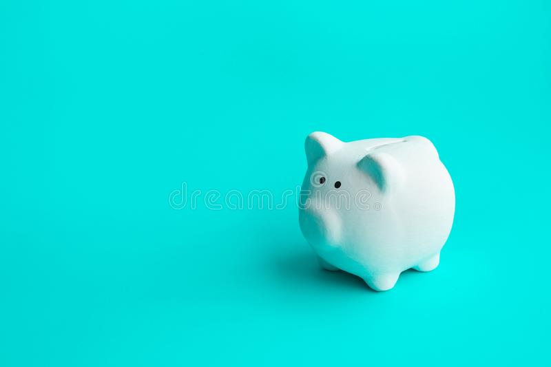 Money and financial concepts with piggy bank on blue background.savings and investment. Ideas royalty free stock image