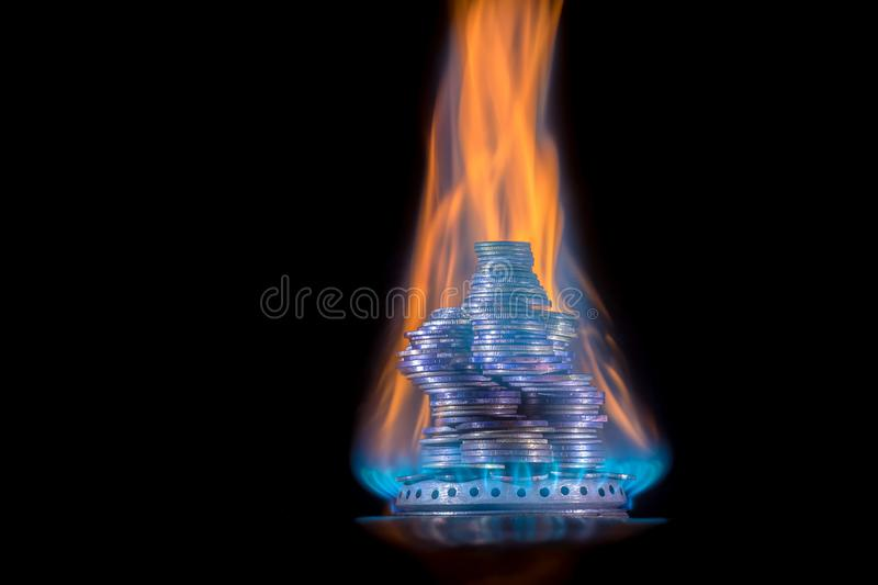 Money on fire. The concept of high prices for natural gas. The concept of high prices for natural gas. Blue flame of burning natural gas from a gas stove with stock image