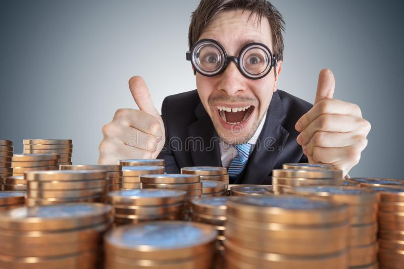 Money in front of a successful rich happy businessman royalty free stock image
