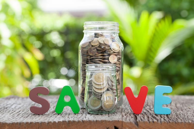 Money in the glass, Save money for investment concept.  royalty free stock photos