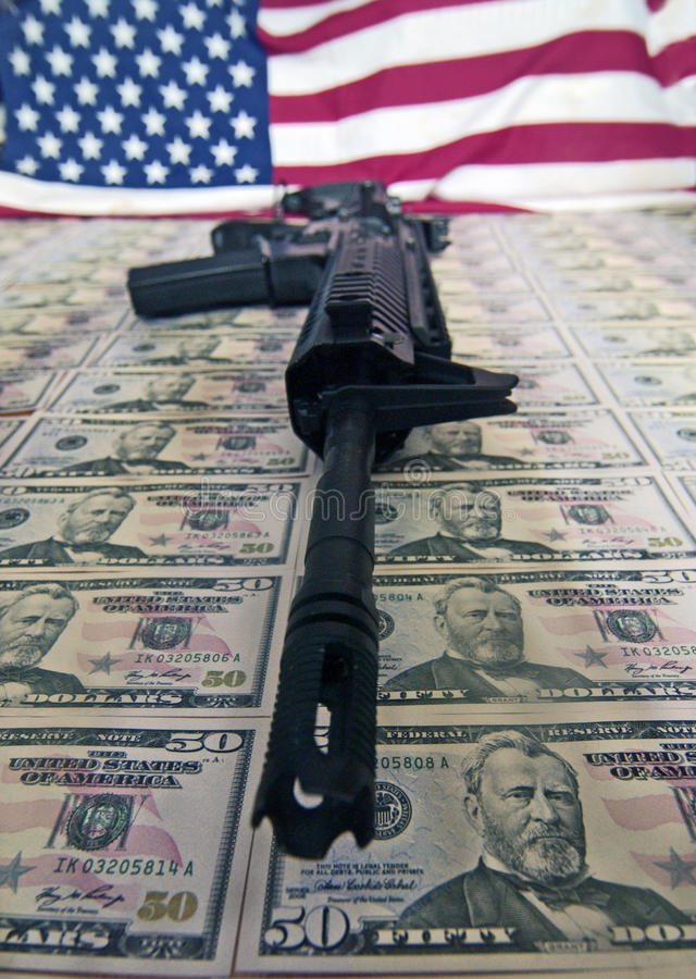 Money,guns and flag royalty free stock photo