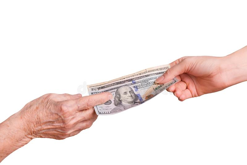 Money in hand isolate on a white background. Handing over money. Financial assistance concept. Senior citizen and money. An elderly man takes money from the royalty free stock photos