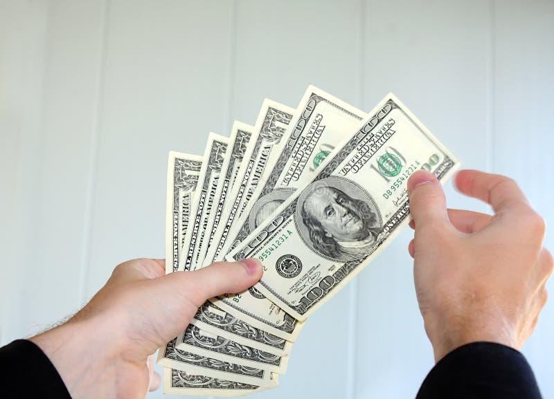 Money in the hands stock photos